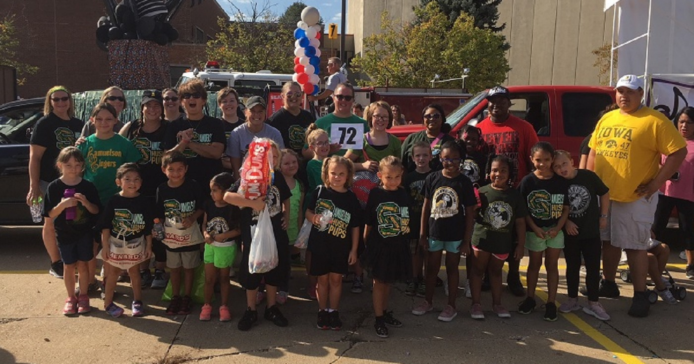 Samuelson students, parents, and staff at the Beaverdale Fall Festival Parade.