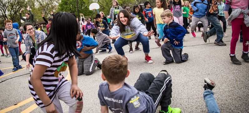 Samuelson staff and students dance to promote healthy choices for Go The Distance Day.